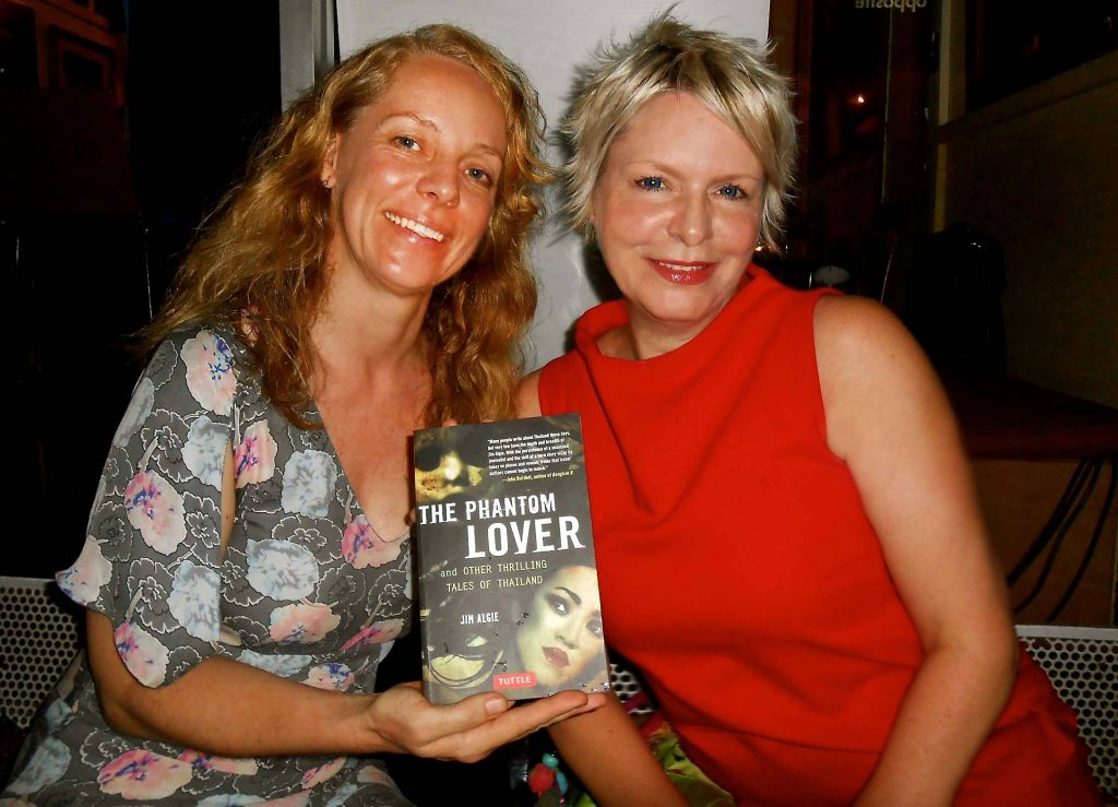 Two female readers pose with signed copy of Asian horror collection