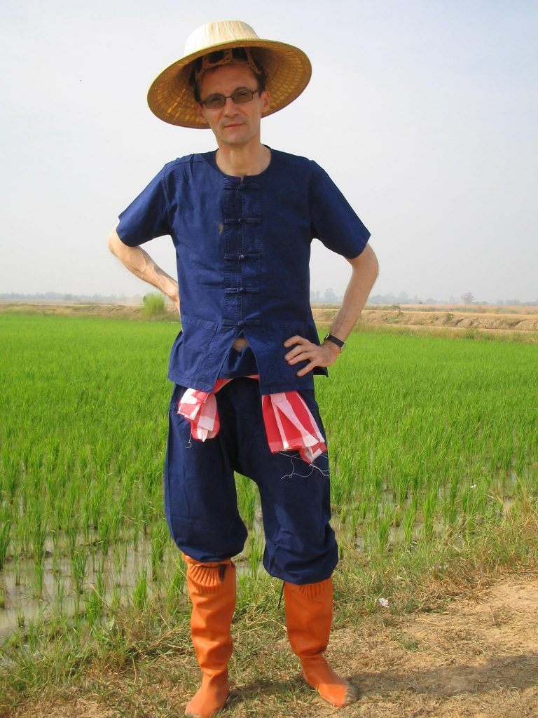 Author Jim Algie dressed up as a rice farmer.