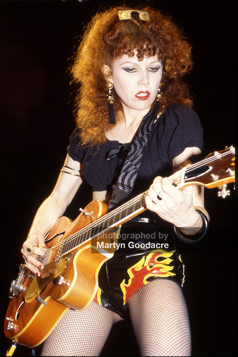 Poison Ivy of the Cramps playing guitar