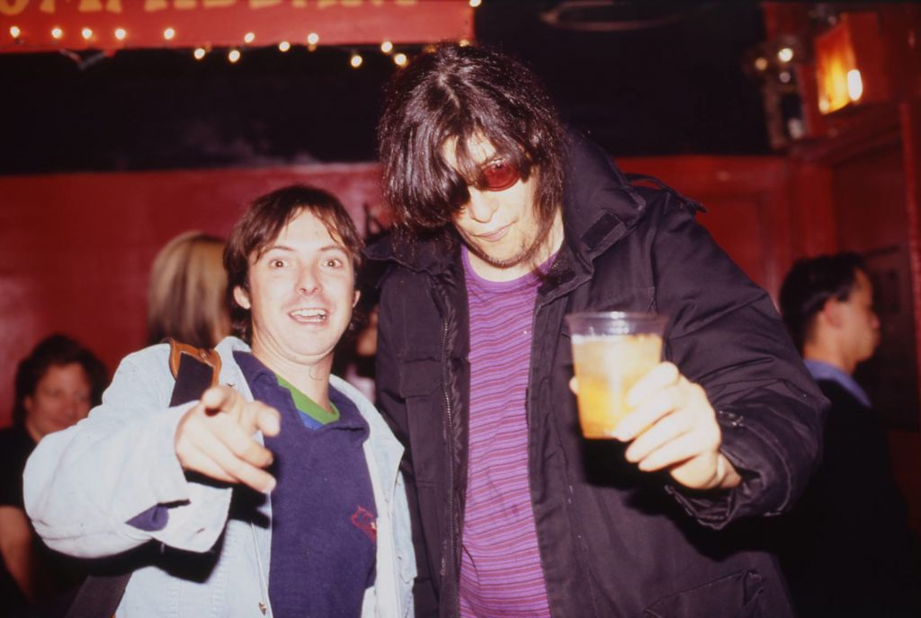 Photo of photographer with Joey Ramone