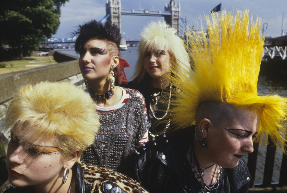Punk girls by River Thames with bridge in background