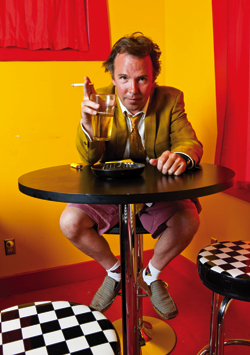 Shot of Doug Stanhope drinking beer