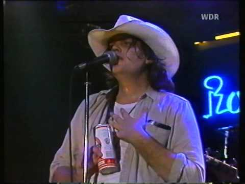 Photo of Dan Stuart in 1985 wearing a cowboy hat